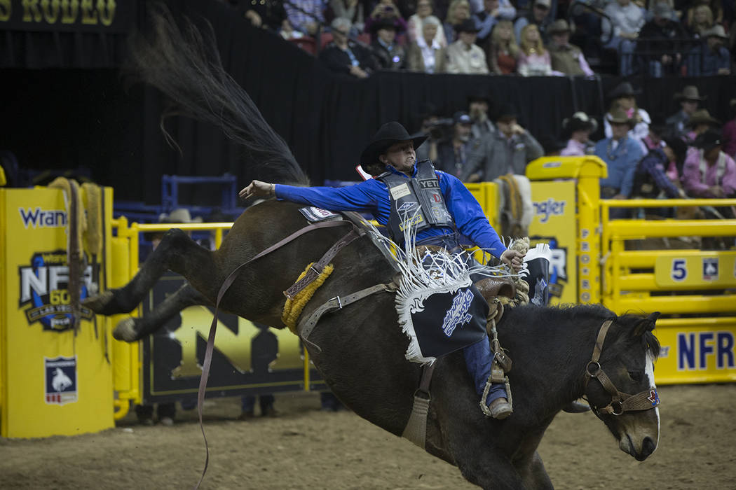 Rusty Wright makes his run during National Finals Rodeo on Monday, Dec. 10, 2018, at Thomas &am ...