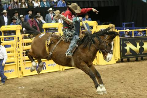 Isaac Diaz of Texas competes in the saddle bronc riding during the third go-round of the Nation ...