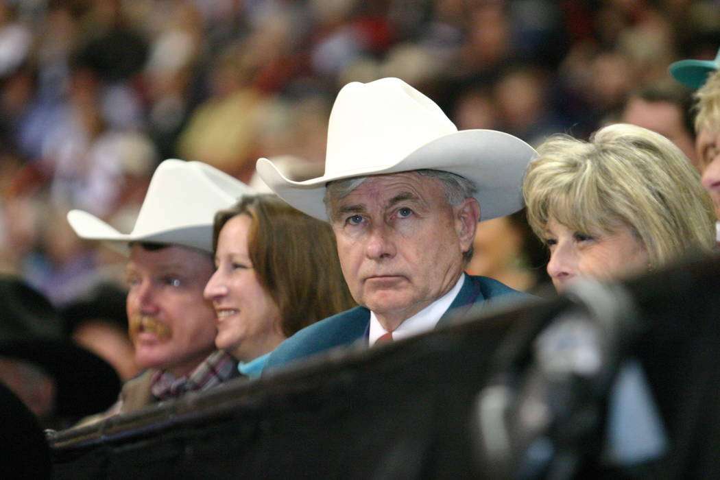 Shawn Davis takes in a go-round of the Wrangler National Finals Rodeo at the Thomas & Mack Cent ...