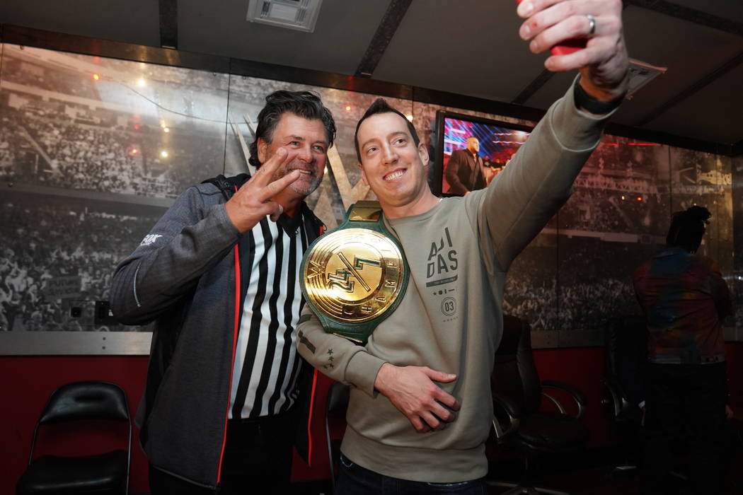 NASCAR Monster Cup champion Kyle Busch, right, with famed driver Michael Waltrip, celebrates ba ...