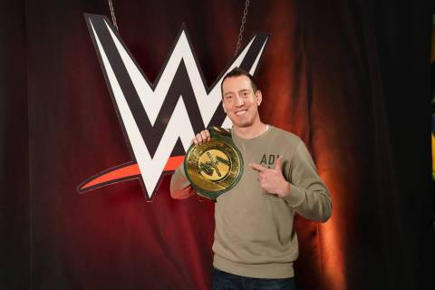 NASCAR Monster Cup champion Kyle Busch poses with the WWE title belt. (True Speed Communications)