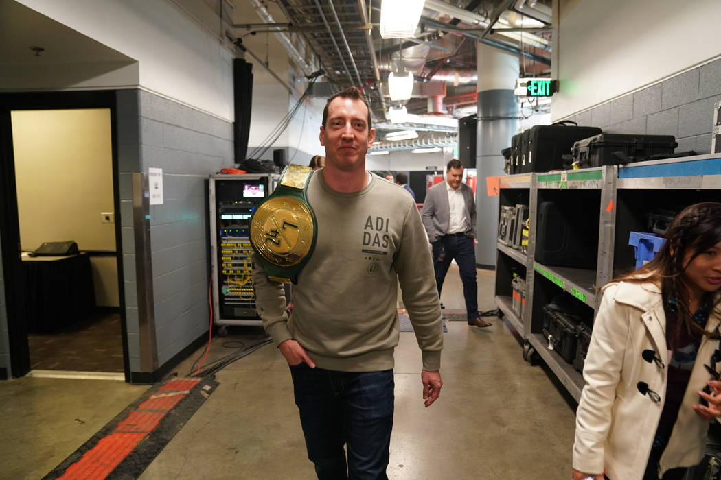 NASCAR Monster Cup champion Kyle Busch walks backstage at Bridgestone Arena in Nasvhille, Tenn. ...