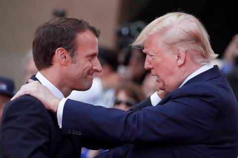French President Emmanuel Macron, left, meets U.S President Donald J. Trump during a ceremony t ...