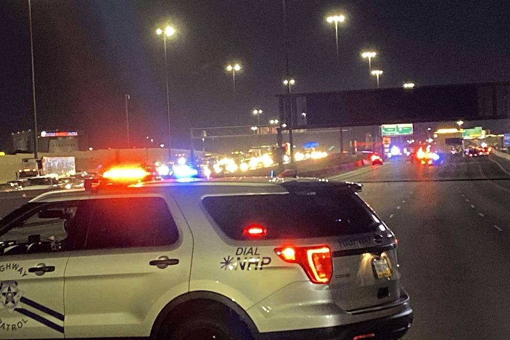 A Nevada Highway Patrol vehicle blocks Interstate 15 as troopers investigate a fatal, wrong-way ...