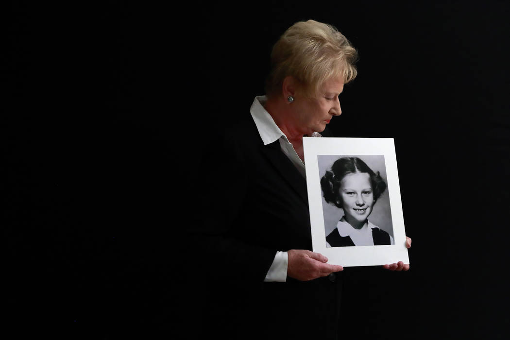 In a Nov. 20, 2019, photo, Nancy Holling-Lonnecker, 71, poses with a picture taken of her as a ...