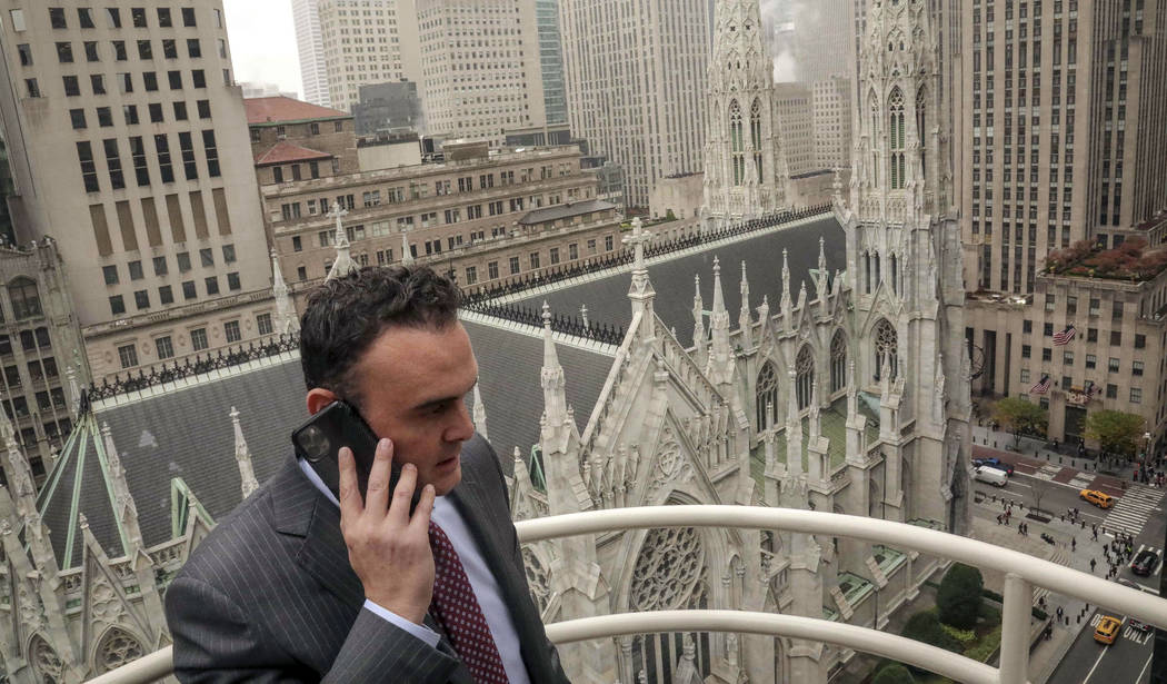 In this Tuesday, Oct. 29, 2019, photo, attorney Adam Slater takes a phone call on a patio outsi ...