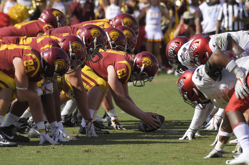 Southern California long snapper Jake Olson (61), who is blind, gets set for a point-attempt du ...