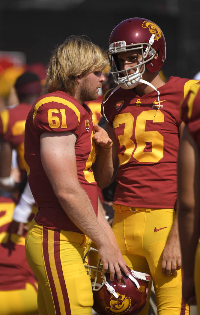 Southern California long snapper Jake Olson, left, who is blind, talks with punter Chris Tilbey ...