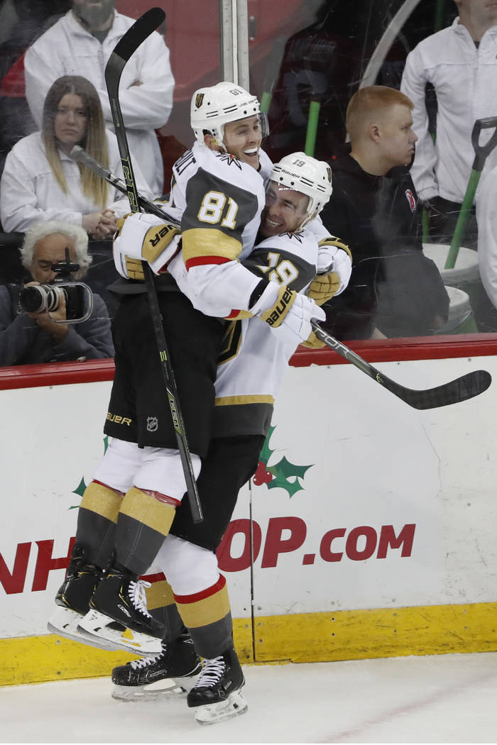 Vegas Golden Knights right wing Reilly Smith (19) lifts center Jonathan Marchessault (81) in th ...