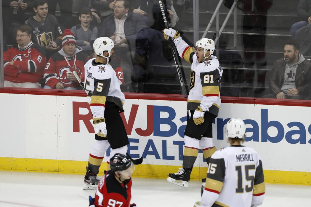 Vegas Golden Knights center Jonathan Marchessault (81) reacts toward defenseman Deryk Engelland ...