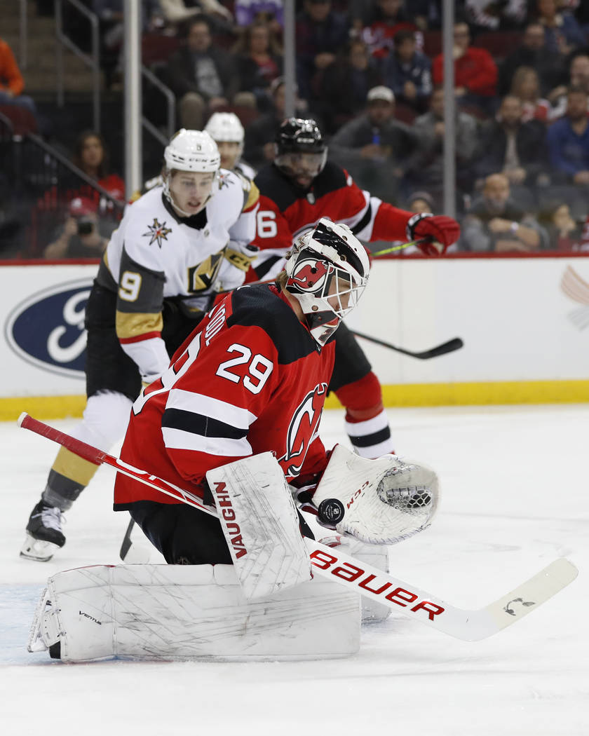 New Jersey Devils goaltender Mackenzie Blackwood (29) bobbles the puck as he makes a save with ...