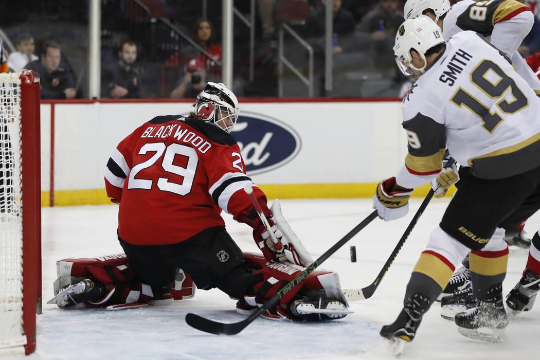 New Jersey Devils goaltender Mackenzie Blackwood (29) blocks a shot with Vegas Golden Knights r ...
