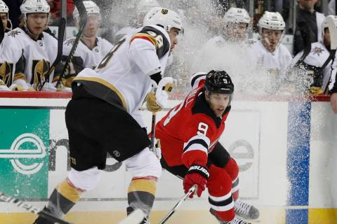 New Jersey Devils left wing Taylor Hall (9) tries to corral the puck away from Vegas Golden Kni ...