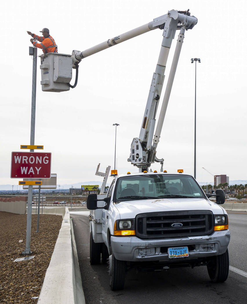 Electrician Sam Martinez with Lam Contracting installs cameras for the Nevada Department of Tra ...