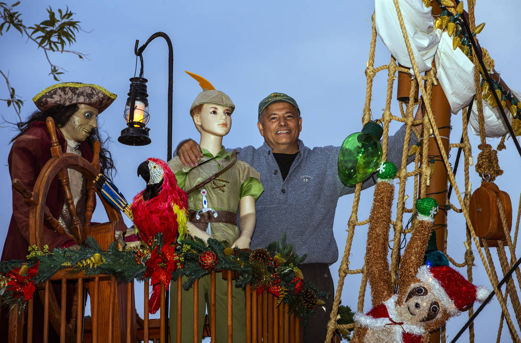 Juan Torres stands atop the pirate ship he built for his wife Maria Acosta as part of a holiday ...