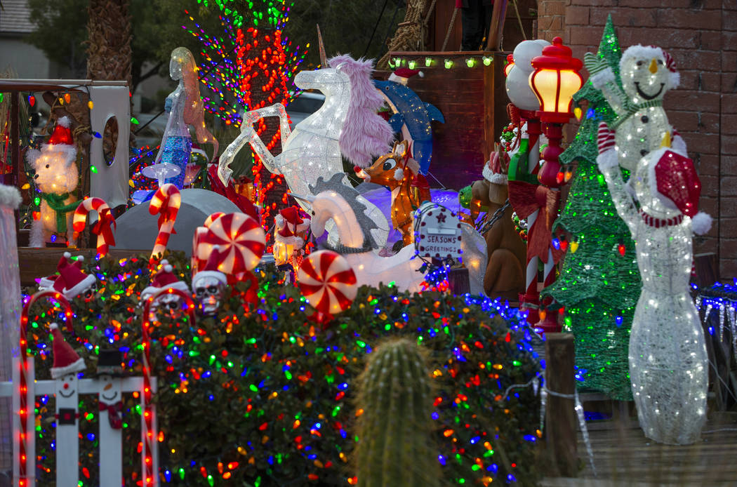 A collection of the holiday lights in the yard of Maria Acosta and Juan Torres which will be fe ...
