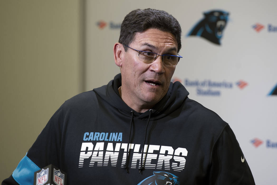 Carolina Panthers head coach Ron Rivera speaks to the media following an NFL football game agai ...
