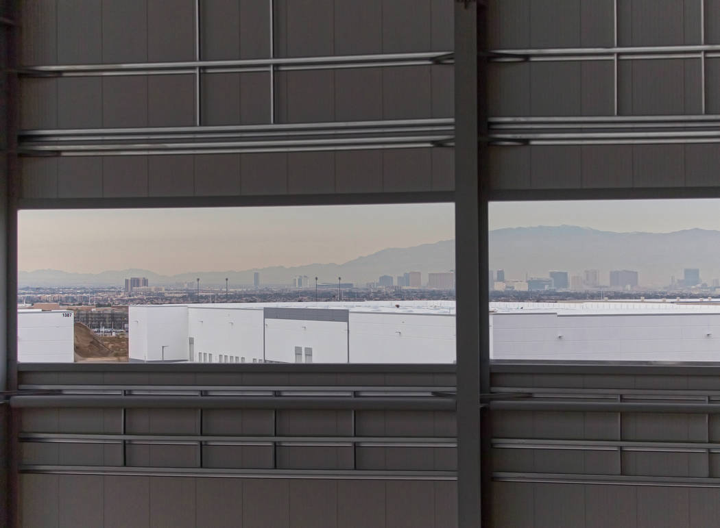 The Las Vegas skyline through a panel of windows at the future Raiders headquarters and practic ...