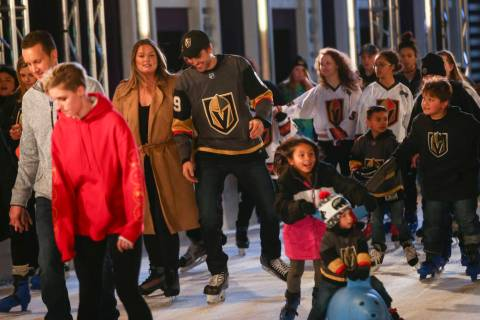 "Golden Knights' Alex Tuch, center left, skates with hockey fans during the ""Night With the ..."