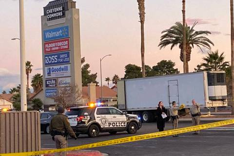Las Vegas police officers respond to the scene of a shooting near the entry of the Cheyenne Com ...
