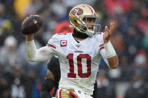 San Francisco quarterback Jimmy Garoppolo throws the ball against the Baltimore Ravens in the f ...