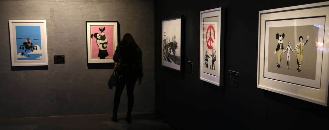 "Taylor Misukonis of St. Louis takes in ""Banksy: Genius or Vandal"" at Immersion Vegas ..."
