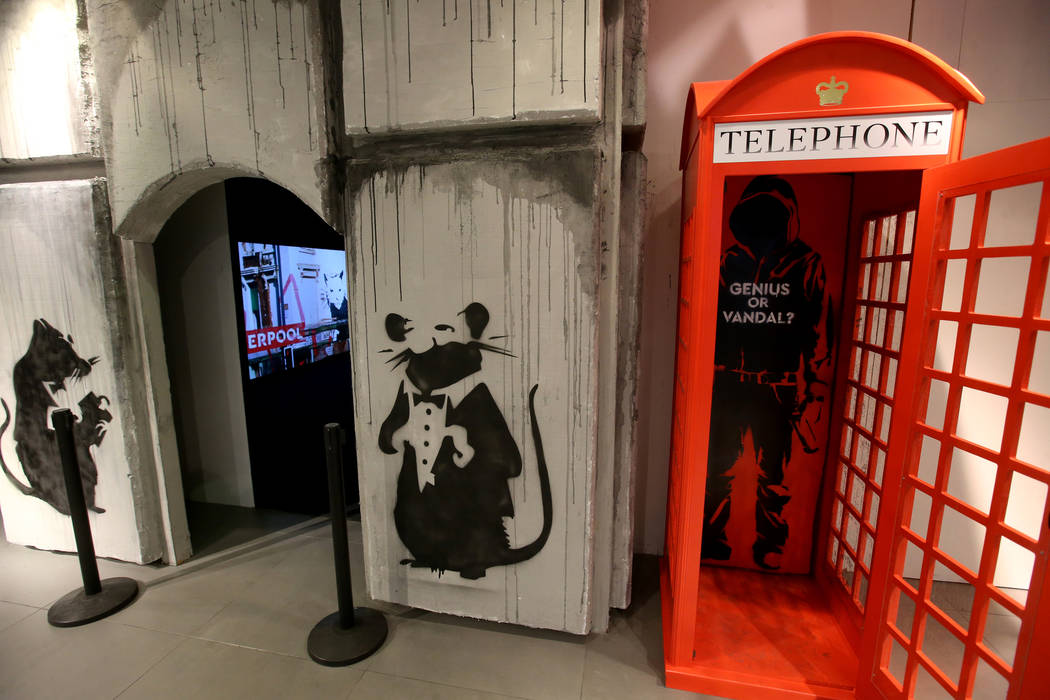 "A selfie spot at the entrance to ""Banksy: Genius or Vandal"" at Immersion Vegas in Fas ..."