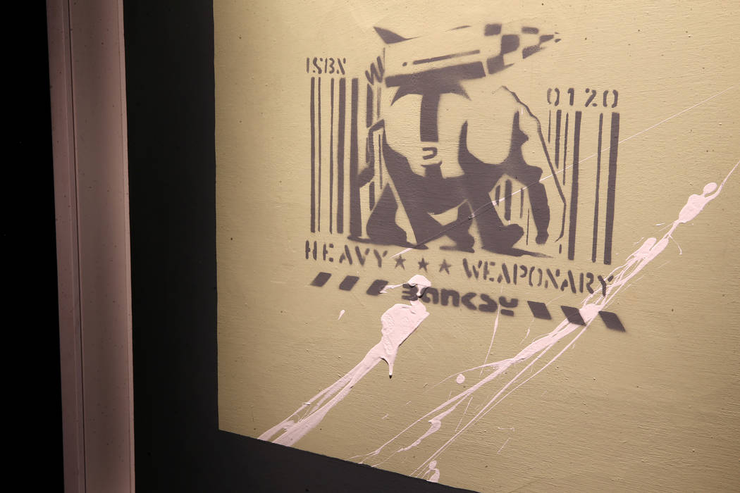 """Heavy Weaponry"" on display in ""Banksy: Genius or Vandal"" at Immersion Vega ..."