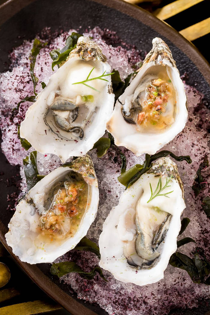 Wood grilled naked cowboy oysters with lemon miso butter and chilled French kiss oysters, Thai ...
