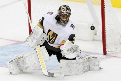 Vegas Golden Knights goaltender Malcolm Subban (30) makes a save as the puck deflects off him d ...