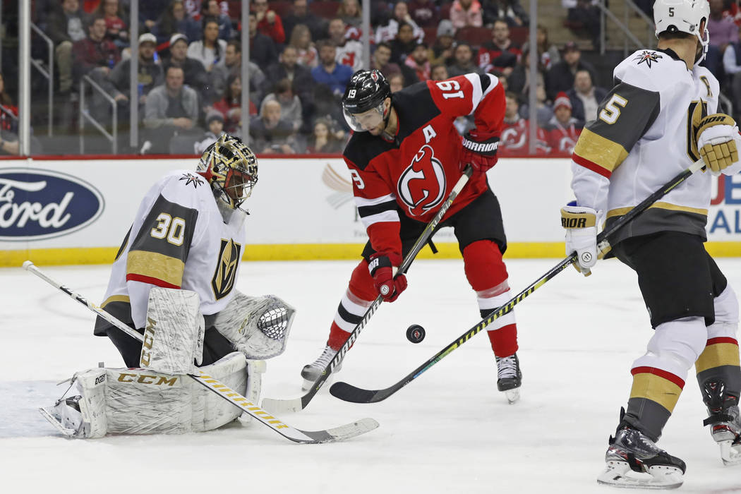 Vegas Golden Knights goaltender Malcolm Subban (30) watches the puck as it bounces in front of ...