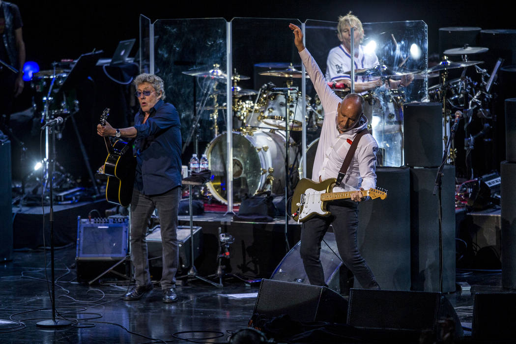 "Roger Daltrey and guitarist Pete Townshend of The Who finish the song ""Who Are You"" a ..."