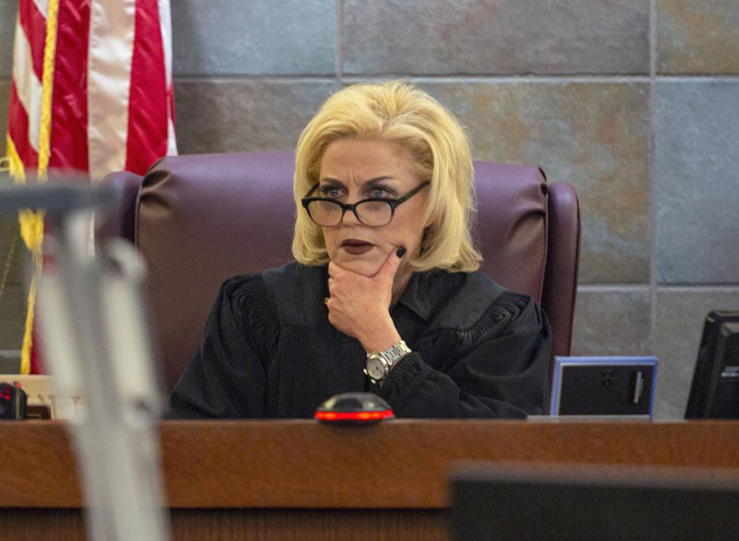 District Judge Michelle Leavitt listens to defense attorney Richard Schonfeld speak on behalf o ...