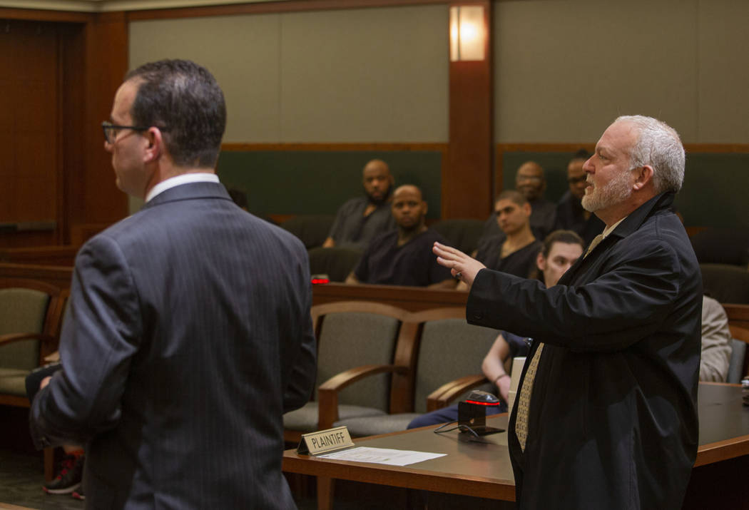 Defense attorney Richard Schonfeld, left, and Chief Deputy District Attorney Marc DiGiacomo spe ...