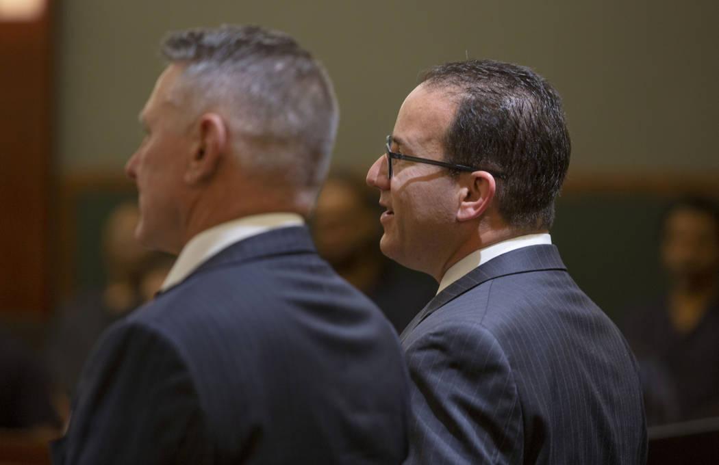 "Gregory ""Brent"" Dennis, left, and defense attorney Richard Schonfeld speak to District Judge Mi ..."