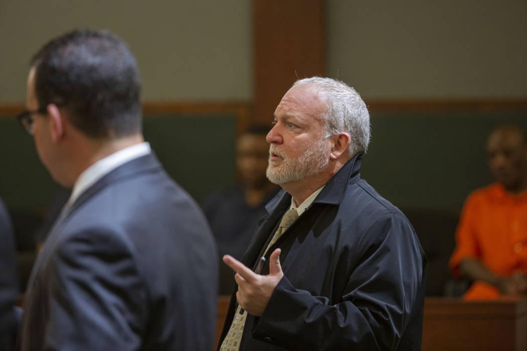 Chief Deputy District Attorney Marc DiGiacomo speaks to District Judge Michelle Leavitt during ...