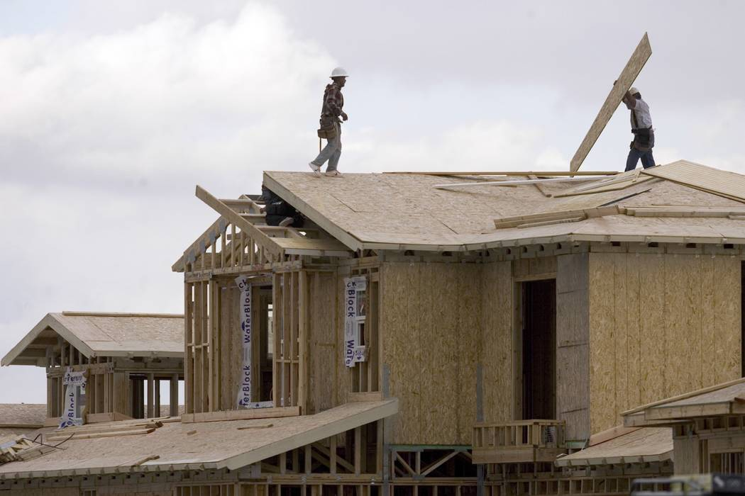 Construction workers build a home in Las Vegas. (Las Vegas Review-Journal file photo)
