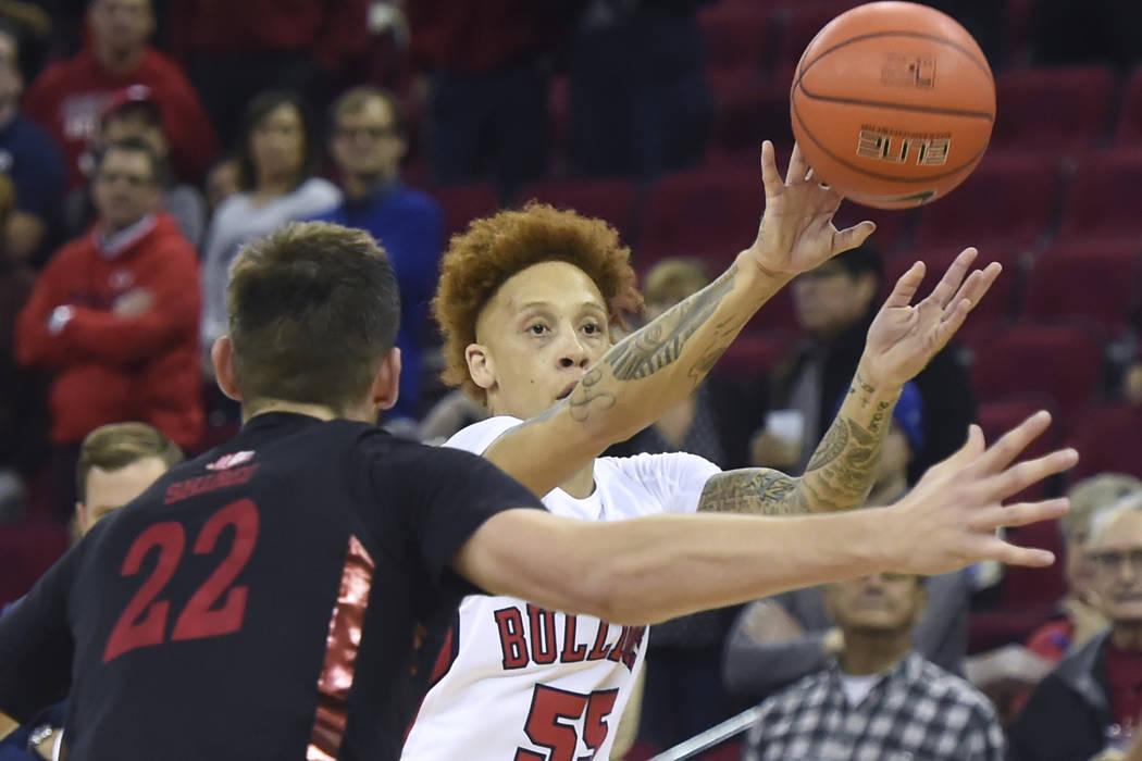 Fresno State's Noah Blackwell, right, passes the ball with UNLV's Vitaliy Shibel, left, defendi ...
