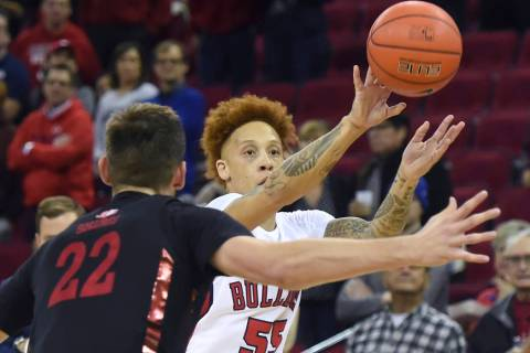Fresno State's Noah Blackwell, right, passes the ball with UNLV's Vitaliy Shibel, left, defendi ...