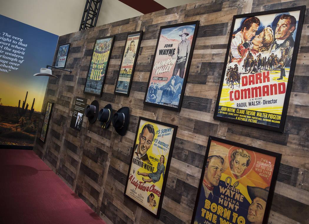 "Framed movie posters staring film icon John Wayne line the walls at the ""John Wayne: Spirit of ..."