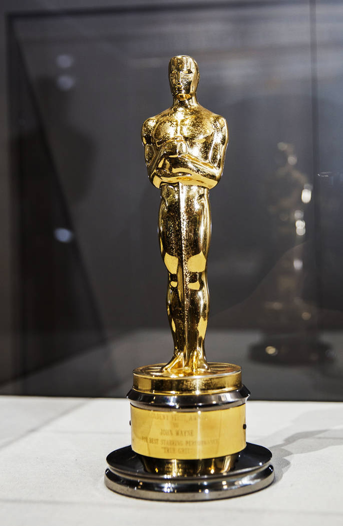 "John Wayne's Academy Award for best actor as Rooster Cogburn in ""True Grit"" presented ..."