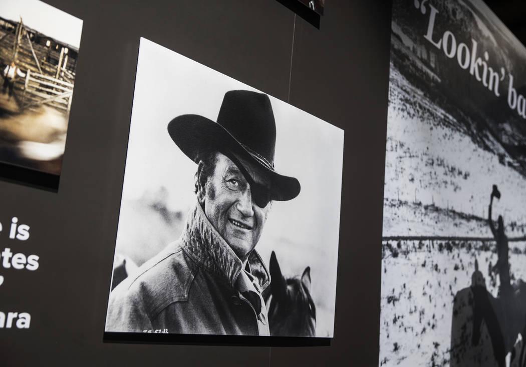 "Photographs of movie icon John Wayne line the walls of the ""John Wayne: Spirit of the West ..."