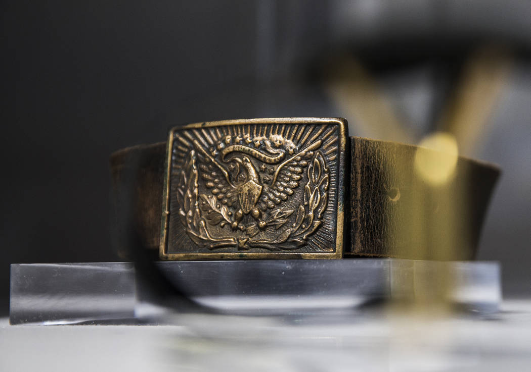 A custom leather belt with American bald eagle buckle worn on screen by film icon John Wayne at ...