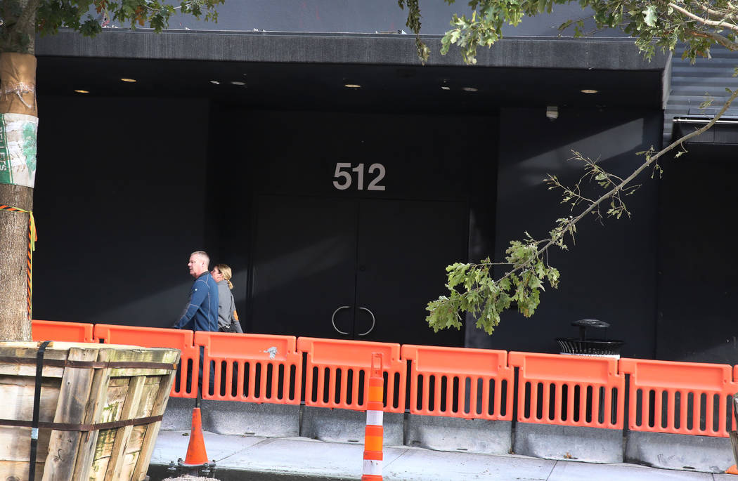 Pedestrians walk past a nightclub, previously known as Red, at 512 Fremont Street on Tuesday, D ...