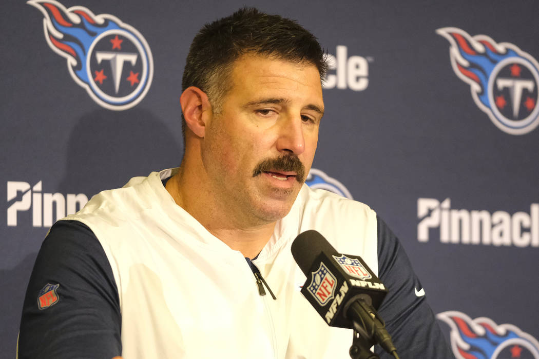 Tennessee Titans head coach Mike Vrabel speaks during a press conference following an NFL footb ...