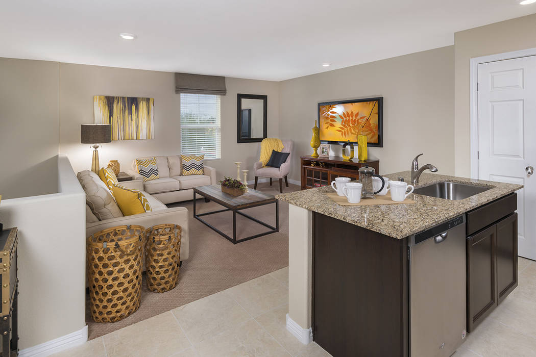 The Bedford town home offers a first-level master suite with two upstairs bedrooms and a great ...