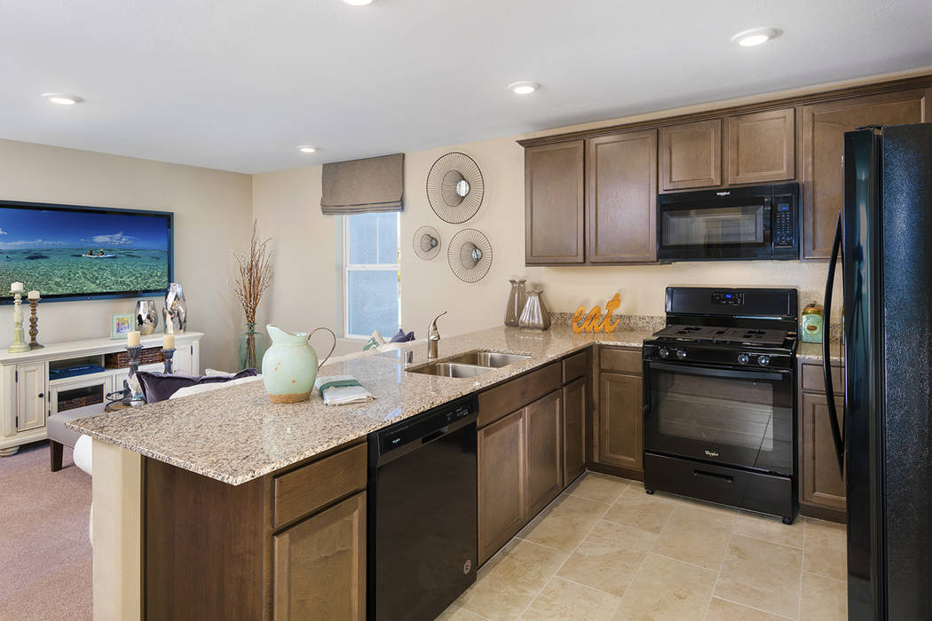 The 1,002-square-foot Griffin town home has a well-equipped kitchen and great room. (Mark Skaln ...