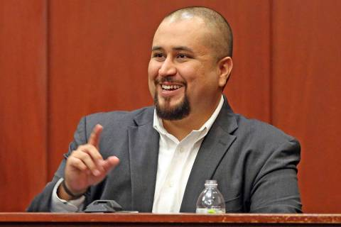 FILE- In this Sept. 13, 2016 file photo, George Zimmerman smiles as he testifies in a Seminole ...