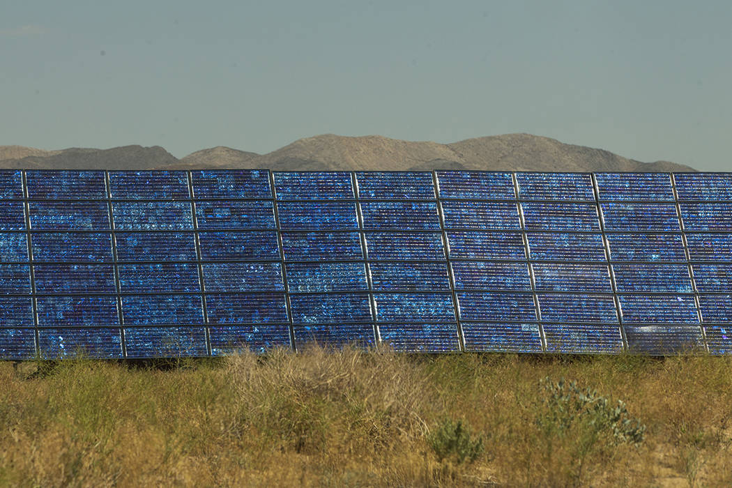 Solar panels generate power on the rim of Bilby crater within the Nevada National Security Test ...