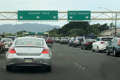 Traffic backs up at the main gates after a shooting at Pearl Harbor Naval shipyard, Wednesday, ...